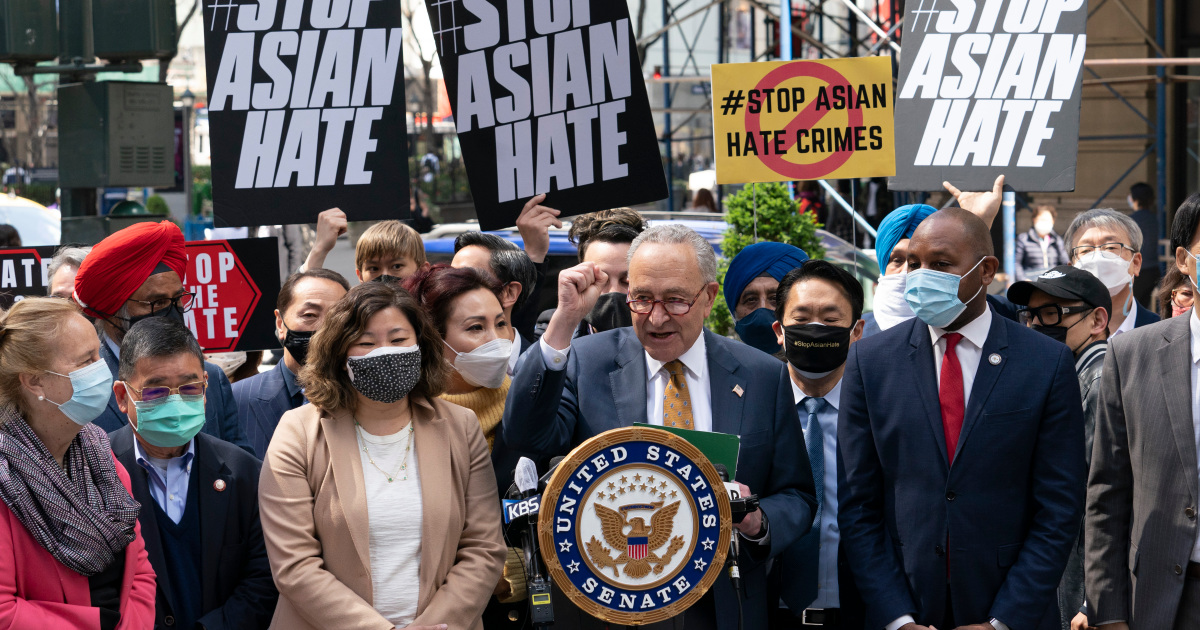 Senate Majority Leader Chuck Schumer, D-N.Y., center, is joined by U.S. Rep.GraceMeng, D-N.Y., third from left, at a news conference to discuss an Asian-American hate crime bill, Monday, April 19, 2021, in New York. Schumer is pushing for passage of the COVID-19 Hate Crimes Act in the Senate. (AP Photo/Mark Lennihan)