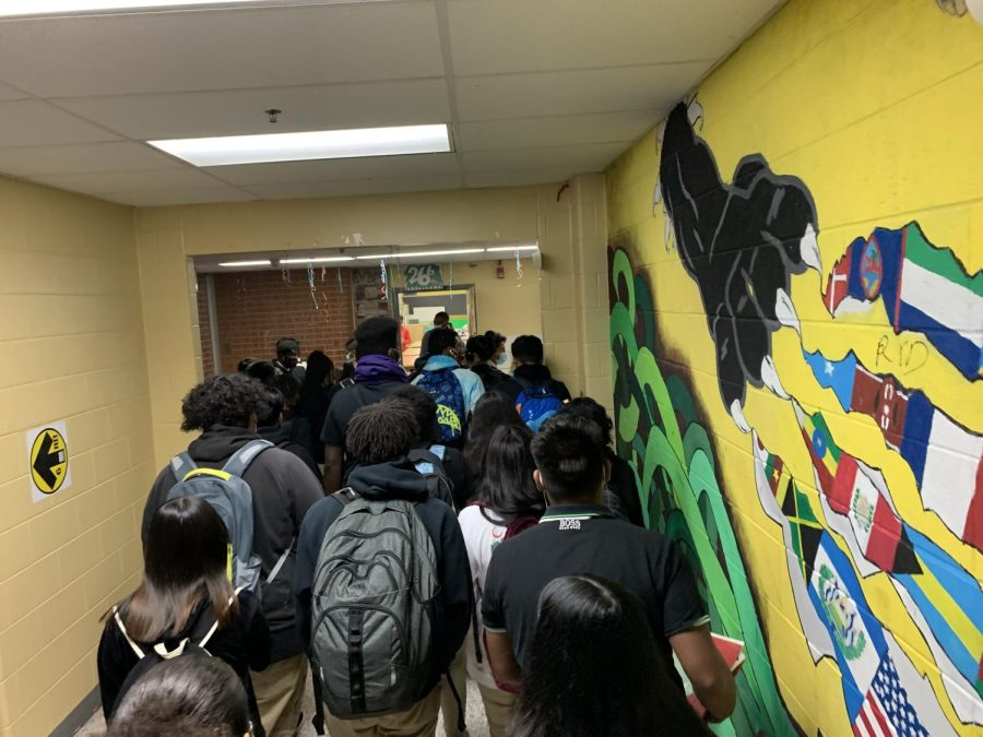 Parkdale students rush to get to their next period class after being in person for weeks.